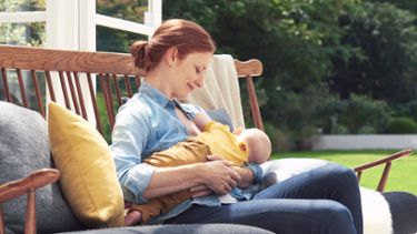 A mother breastfeeding her baby, something that can be made possible with Medela ContactTM nipple shields.