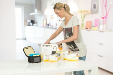 Woman looking at Medela's products and accessories