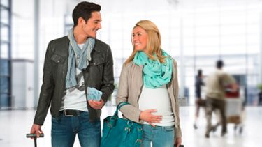 Mum and dad travelling with Medela Harmony breast pump